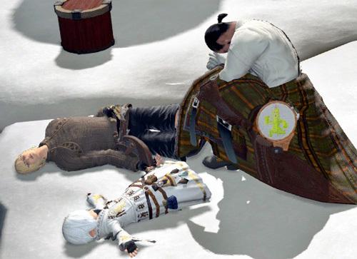 二人の遺体に祈る