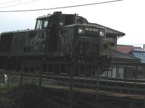 DE10-1207