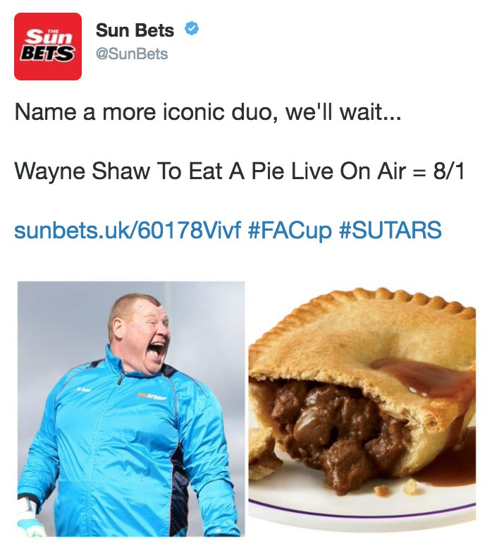 Sutton United backup goalkeeper Wayne Shaw having a mid-game pie
