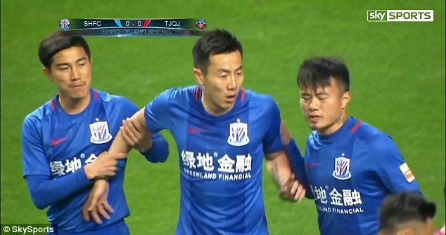 Qin Sheng (centre) has been reprimanded by Shanghai Shenhua for a stamp on Axel Witsel