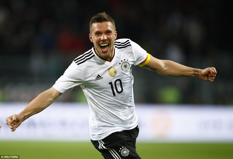 The 31-year-old celebrates marking his final appearance for Germany with an incredible strike from distance