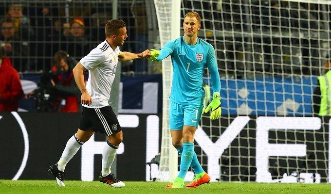 Joe Hart congratulating Lukas Podolski on his final international goal for Germany