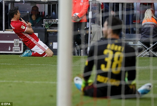 Lewandowski celebrates doubling Bayerns lead while Burki looks despondent