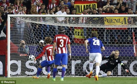 Atletico Madrids Antoine Griezmann scores their first goal from the penalty spot after sending