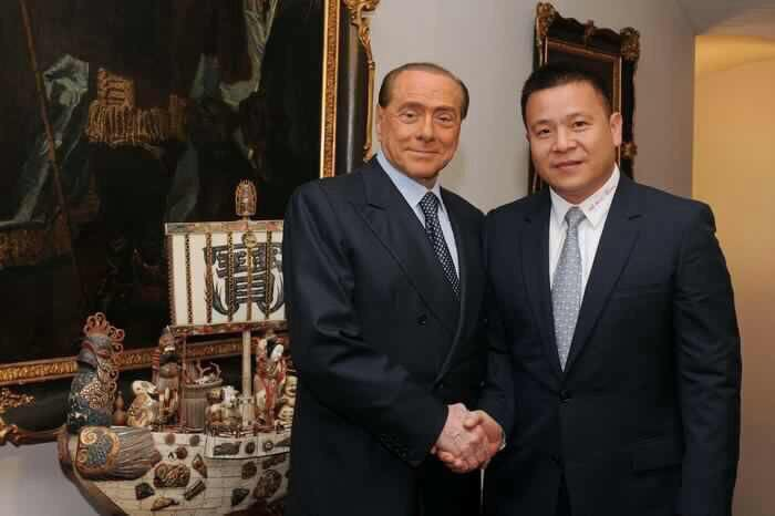 Yonghong Li with Silvio Berlusconi