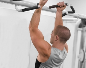 15398-a-healthy-young-man-performing-pull-ups-in-a-gym-pv-crop.jpg