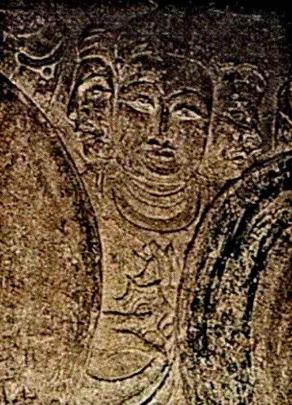 四川省の広元千仏崖の釈迦多宝仏窟・阿修羅像~法輪を持つ